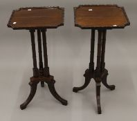 A pair of reproduction mahogany side tables. Each 36.5 cm square., 72 cm high.