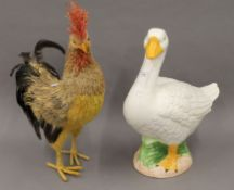A pottery model of a goose and a model of a cockerel. The former 50 cm high.