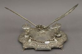 A 925 silver desk stand. 28 cm wide. 28.8 troy ounces total weight.