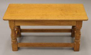 A Robert 'Mouseman' Thompson of Kilburn rectangular adzed oak coffee table. 82 cm long, 35.