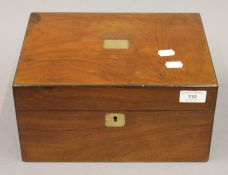 A Victorian walnut sewing box with fitted interior. 30 cm wide.
