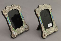 A pair of Art Nouveau style silver photograph frames. 21 cm high.