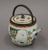 A 17th/18th century Chinese porcelain teapot, with adapted handle. 13 cm high.
