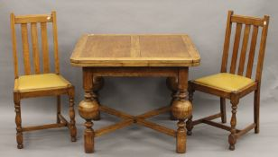 A golden oak drawer leaf table with four chairs. 91 cm long closed, 163 cm long open.
