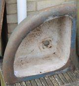 A Victorian cast iron corner manger.