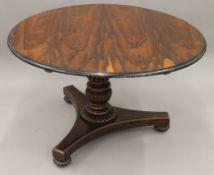 A 19th century rosewood tilt top breakfast table. 120 cm diameter.