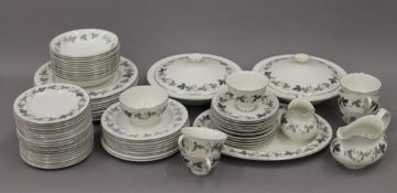 A quantity of Royal Doulton Burgundy pattern dinner wares.