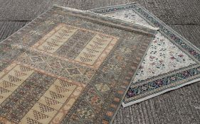 Two large modern cream rugs, one with floral pattern. 160 x 220 cm.