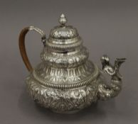 An embossed Dutch silver teapot, possibly Dutch Colonial. 16.5 cm high. 18.