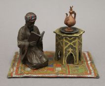A cold painted bronze inkwell formed as an Arab. 14 cm wide.