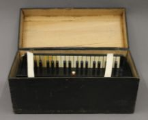 A 19th century accordion Harmoniflute by Busson Paris , boxed. The box 52.5 cm wide.