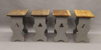 A set of four chapel stools. Each 45 cm high.