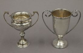 Two small silver trophy cups. The largest 11 cm high. 4.4 troy ounces.