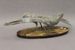 An Art Deco animalier sculpture formed as golden pheasants. 70 cm long.