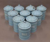 A set of vintage enamel kitchen tins. Approximately 20 cm high.