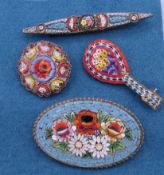 Four vintage Italian micro mosaic brooches. The largest 6.5 cm high.