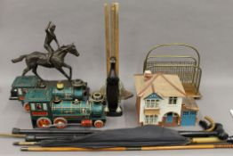 A quantity of miscellaneous items, including a horse racing trophy, an umbrella, a magazine rack,