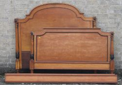 A 19th century satin walnut bed. 143 cm wide.