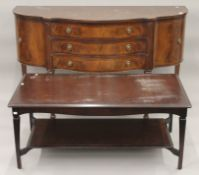 A reproduction mahogany sideboard and a coffee table. The latter approximately 120 cm long.