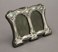 An Art Nouveau style sterling silver double photograph frame. 11 cm wide.