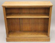 An early 20th century oak open bookcase. 105 cm wide.