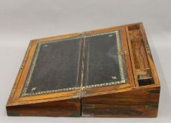 A Victorian brass bound walnut writing slope. 50 cm wide.