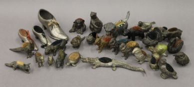A collection of various Victorian and later novelty pin cushions, mostly formed as animals.