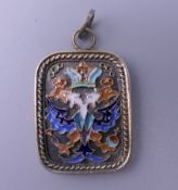 A silver and enamel pendant, bearing Russian marks. 3.5 cm high.