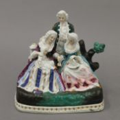 A 19th century Continental porcelain figural desk stand. 15.5 cm high.