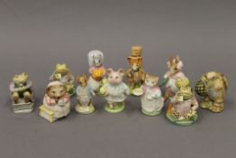 A collection of Beswick and Royal Albert Beatrix Potter figurines.