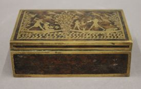 An Art Deco French brass inlaid burr wood cigarette box. 15.5 cm wide.
