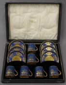 A cased Collingwood bone china coffee set. The case 36.5 cm wide.