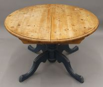 A modern pine kitchen table with blue painted base. 122 cm wide.