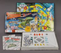 A Thunderbirds Tracy Island, rockets and figures plus game.