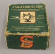 A boxed Singer For the Girls sewing machine. The box 18 cm wide.