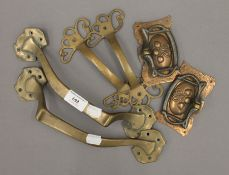 A small quantity of Art Nouveau door and furniture handles. The largest each 28 cm long.