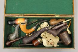 A collection of pipes and cigarette holders, including Meerschaum.