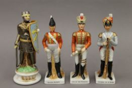 Four porcelain models of soldiers. The largest 23 cm high.
