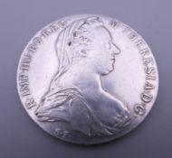 A Maria Theresa 1 Thaler silver coin.