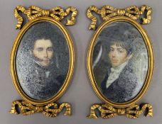 A pair of gilt framed miniatures. 23.5 cm high.