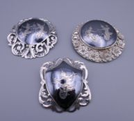 Three sterling silver niello brooches (all made in Siam). Each approximately 5 cm diameter.