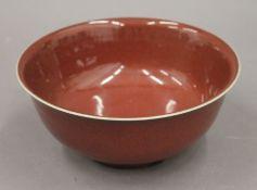 A Chinese sang de boeuf porcelain bowl. 19 cm diameter.