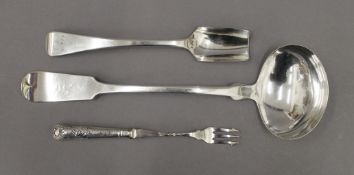 A George IV silver stilton scoop spoon, a silver handled pickle fork and an antique plated ladle.
