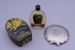 A Continental engraved silver compact and a bottle of vintage boxed Le Mimosa Parisian perfume.