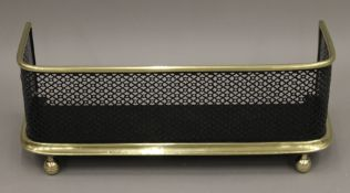 A Victorian brass and iron fender. 62 cm wide.