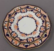 A Royal Crown Derby porcelain dish and two plates. The former 25.5 cm diameter.