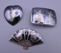 A sterling silver niello heart shaped brooch,