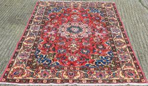 A red ground Hamadan carpet. 222 x 144 cm.