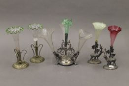 A quantity of various small silver plate and glass epergnes. The largest 26 cm high.