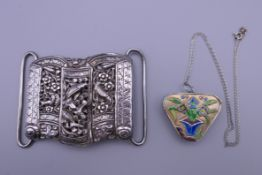 A Chinese silver and enamelled locket and chain, and an antique Chinese silver buckle, stamped.